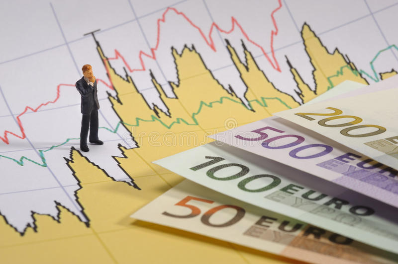 Euro and chart. Business man on finance stock chart with euro currency royalty free stock photo