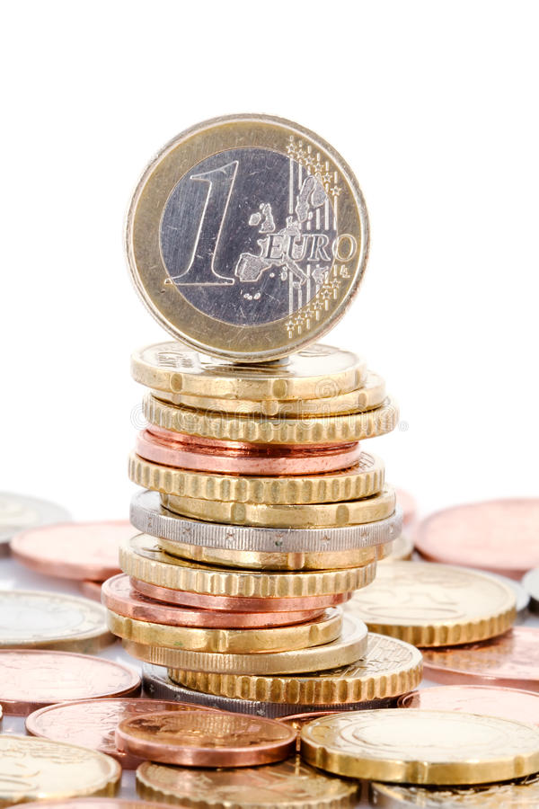 Euro coin balancing on stack royalty free stock photos