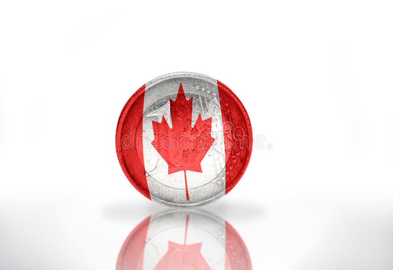 Euro coin with canadian flag royalty free stock photos