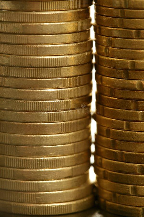 Euro coin columns, golden cash over white stock image