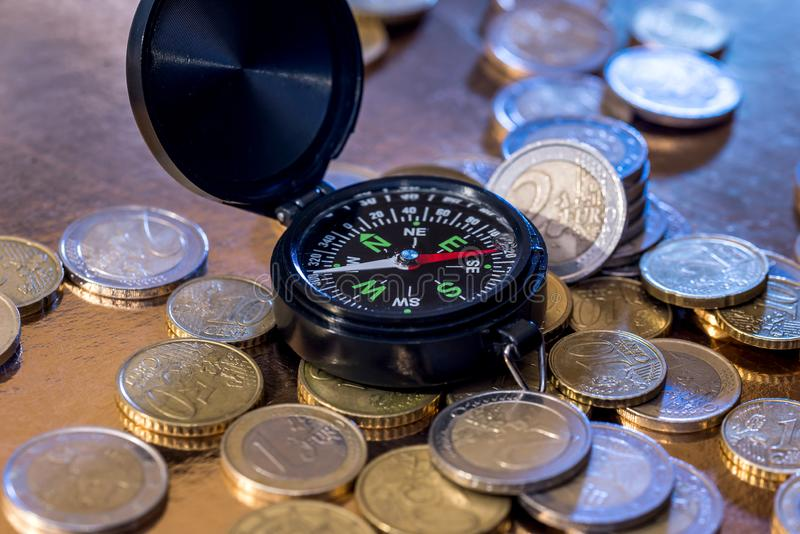 Euro coin and compass. Concept for financial direction. royalty free stock photography