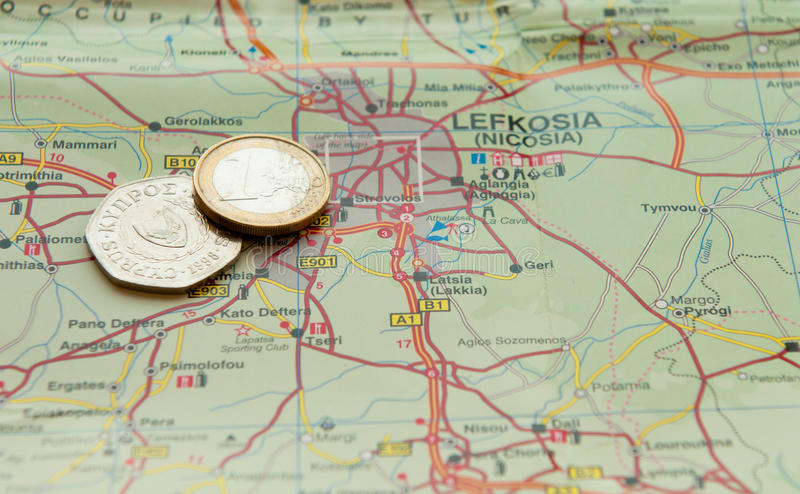 Euro coin and Cyprus cents. One Euro coin and old Cyprus Cents on a map. Concept of financial crisis in Cyprus stock image