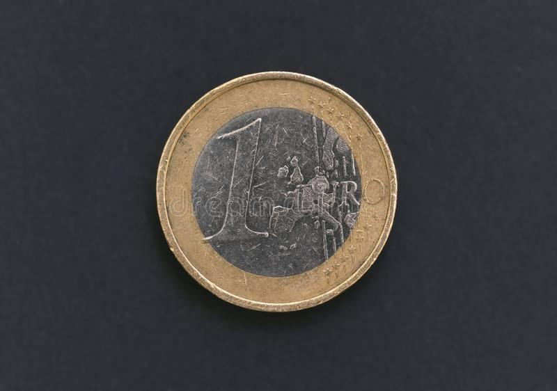1 euro coin. Isolated on black background stock images