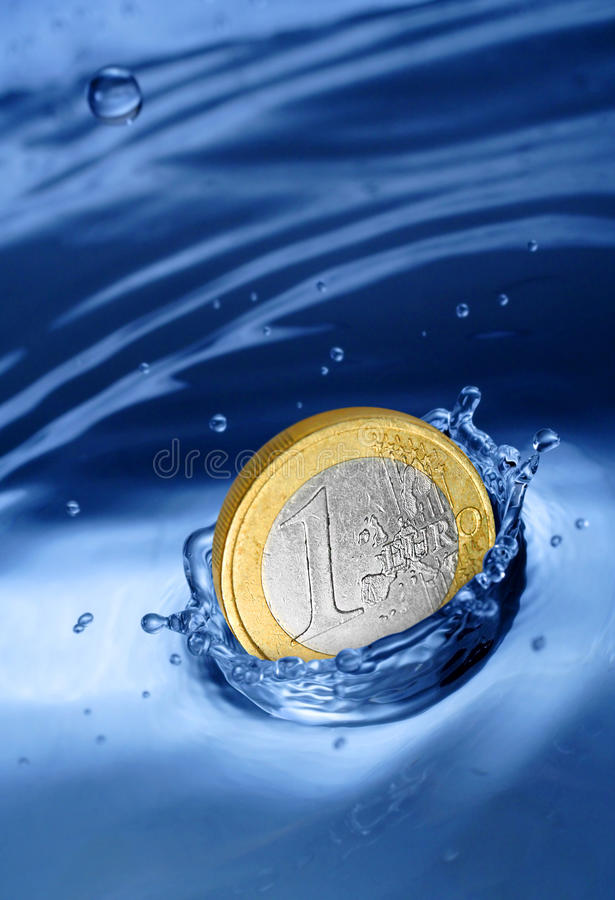 Euro coin falling to the water. royalty free stock photo