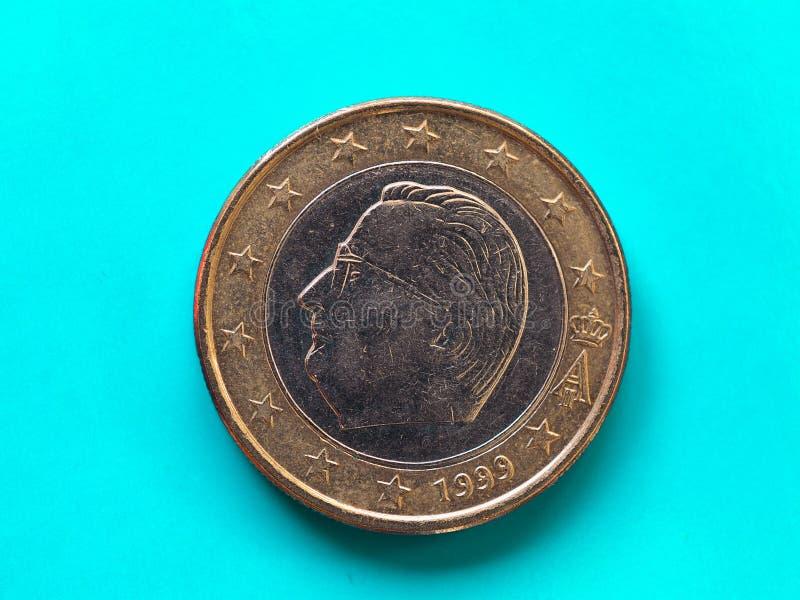 1 euro coin, European Union, Belgium over green blue. 1 euro coin money (EUR), currency of European Union, Belgium over green blue background royalty free stock images