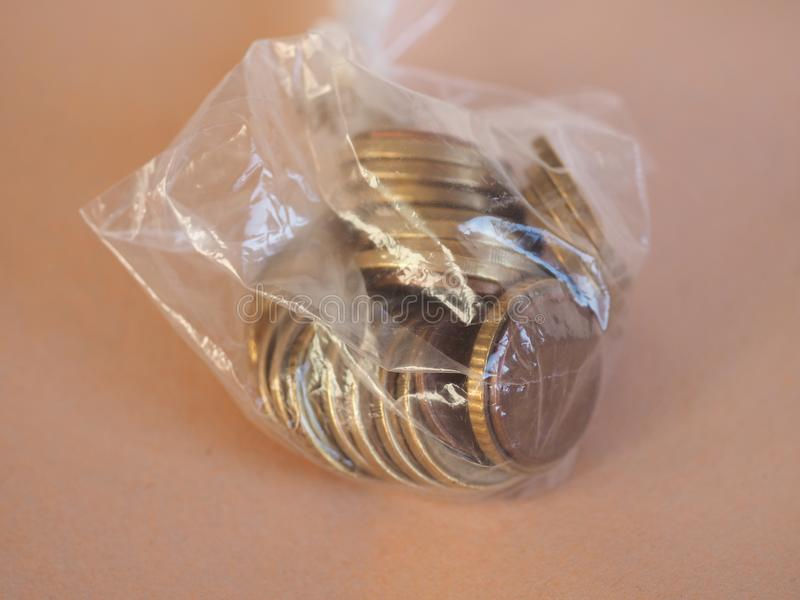 1 euro coin, European Union. 1 euro coin money EUR, currency of European Union, in a plastic bag royalty free stock images