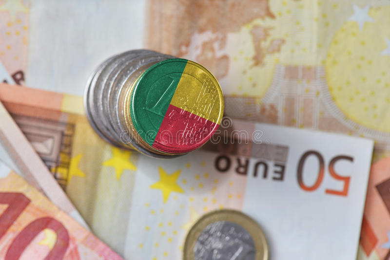 Euro coin with national flag of benin on the euro money banknotes background. Finance concept royalty free stock image