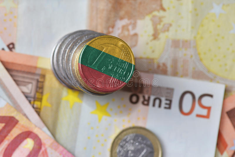 Euro coin with national flag of lithuania on the euro money banknotes background. stock image