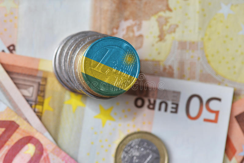 Euro coin with national flag of rwanda on the euro money banknotes background. Finance concept royalty free stock photography