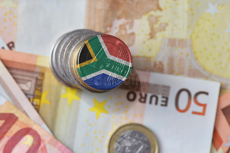 Euro coin with national flag of south africa on the euro money banknotes background. Finance concept stock images