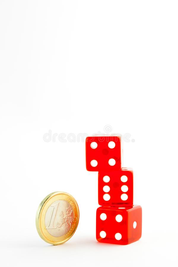 Euro coin near a pile of red dice royalty free stock images