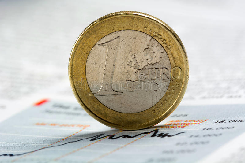 Euro coin on newspaper graph - Stock Image royalty free stock photography
