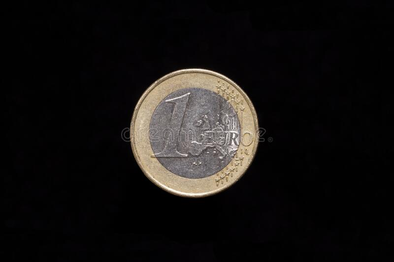 1 Euro coin, reverse side. Isolated on black background royalty free stock photos