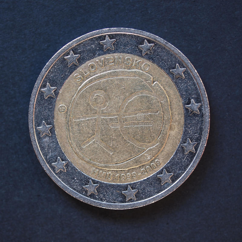 2 Euro coin from Slovakia. Commemorative 2 Euro coin (Slovakia 2009 - 10th anniversary of Euro currency circulating) over black background royalty free stock images
