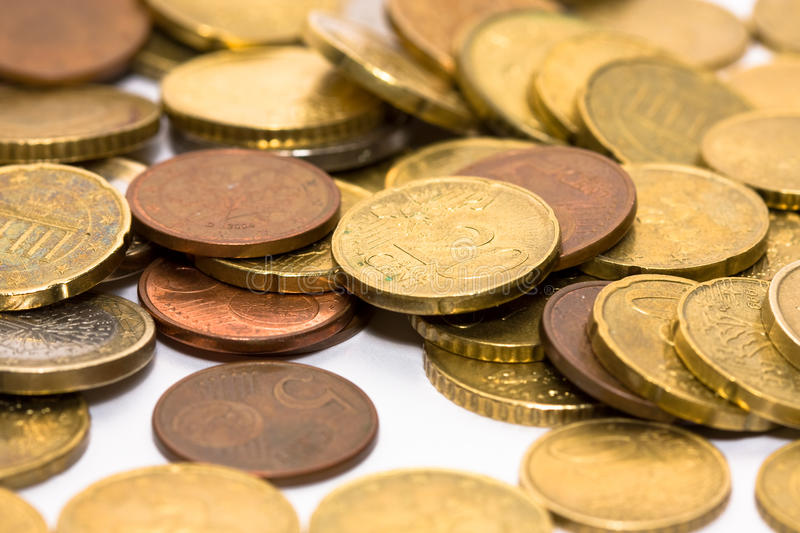 Euro coins. A pile of euro coins isolated on white royalty free stock image