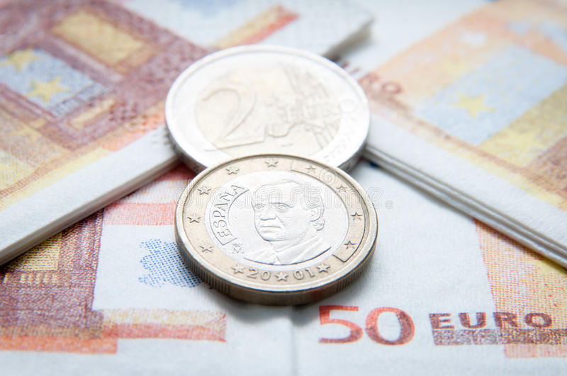 Euro coins and bills royalty free stock photo