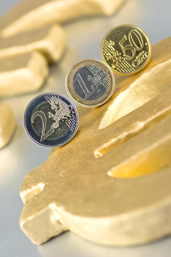Download Euro-Coins On A Euro-Sign Royalty Free Stock Photos - Image: 9995778