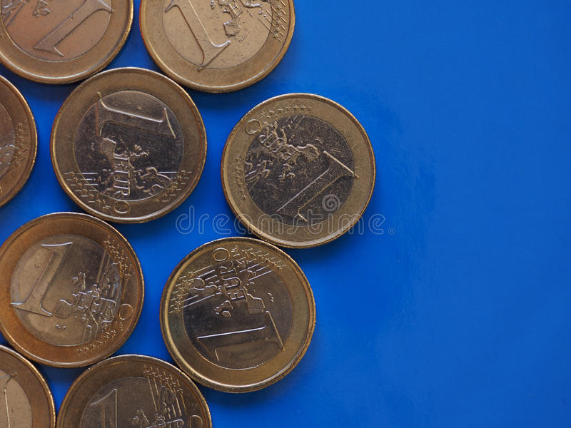 Euro coins, European Union over blue with copy space. Euro coins money EUR, currency of European Union over blue background with copy space stock photography