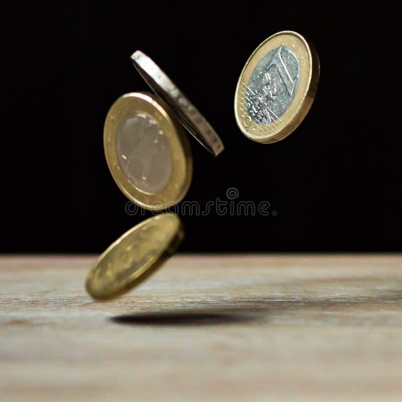 Euro coins falling midair