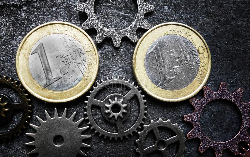 Euro coins and gears stock photos