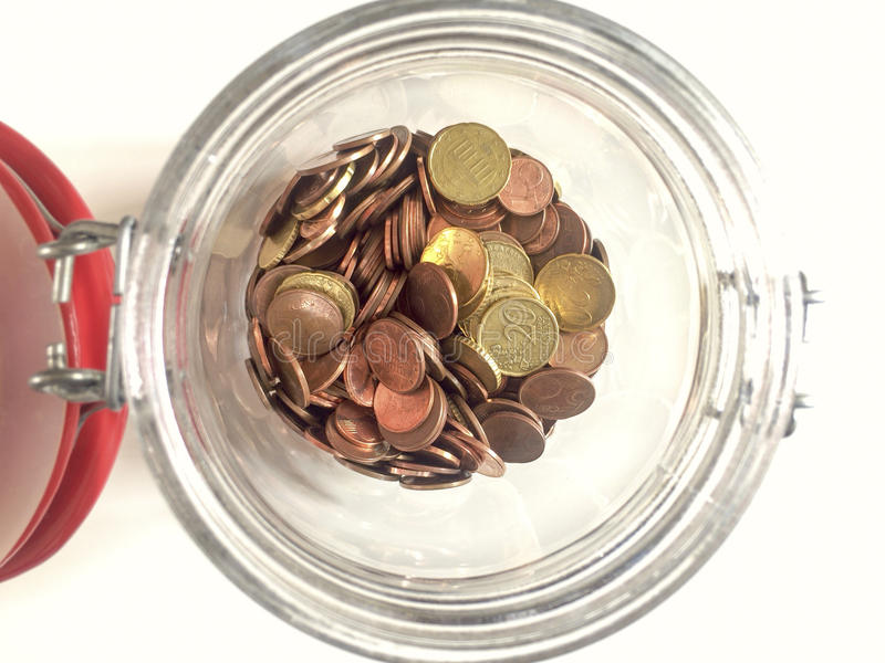 Euro coins in a glass jar royalty free stock image