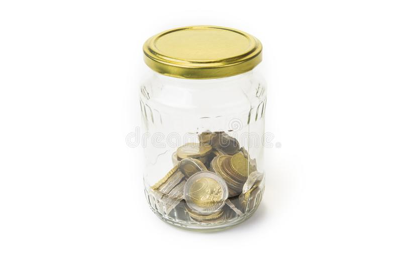 Euro coins in the glass jar on the white background. stock photography