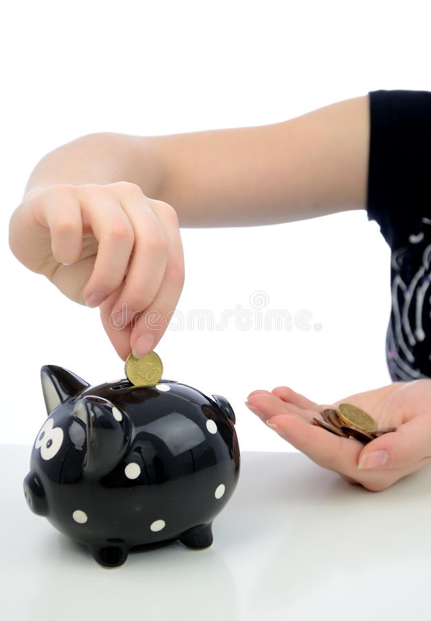 Euro coins investment to piggy bank royalty free stock image