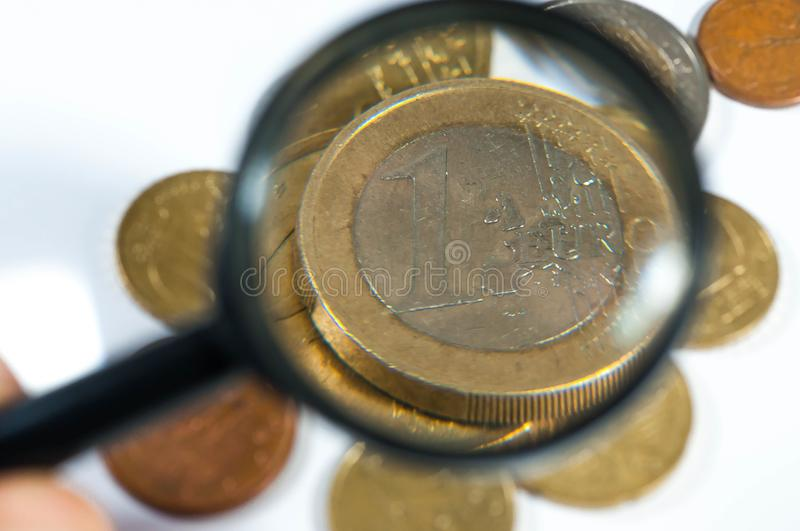 Euro coins, magnifying glass close up. stock images
