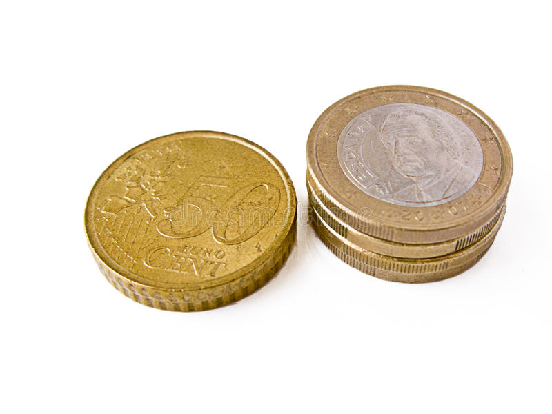 Euro coins: one euro and 50 cents. Some euro coins in piles: 50 cents pile and one euro pile stock images