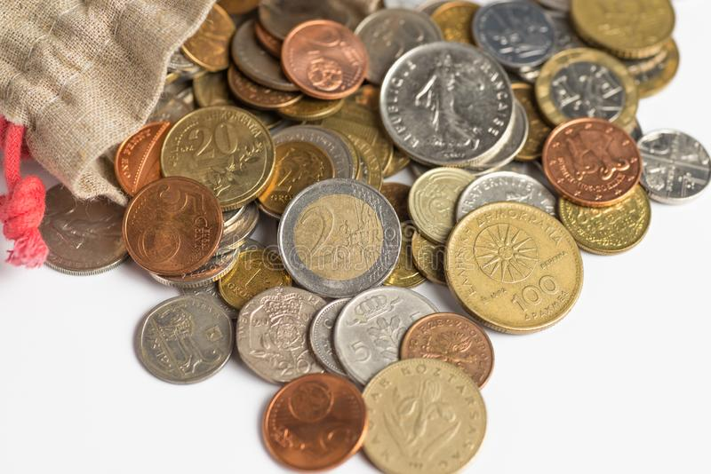 Euro coins pour out of the bag. Background of Euro coins money royalty free stock image