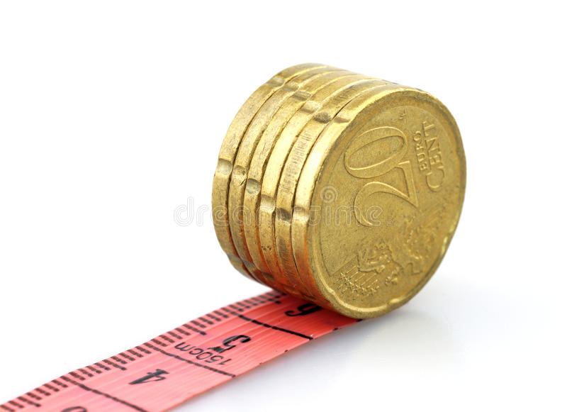 Euro coins running on tape royalty free stock photography