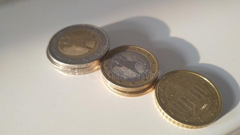 Euro coins  on a table stock image