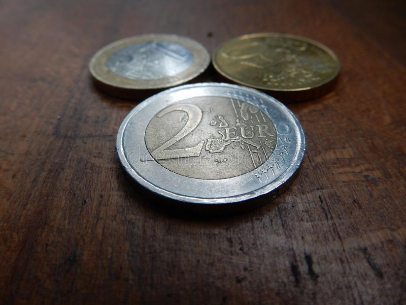 Euro coins on wooden background stock photo