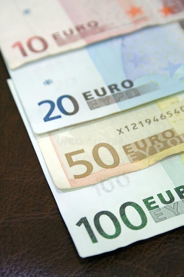 Euro- contas no calendário fotografia de stock