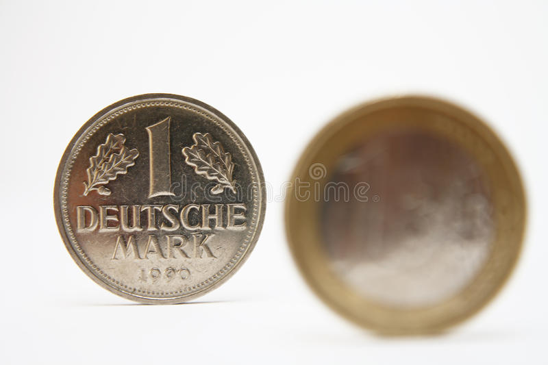 Euro crises and deutsche mark. Euro crises returns to Deutsche Mark currency isolated on white royalty free stock photo