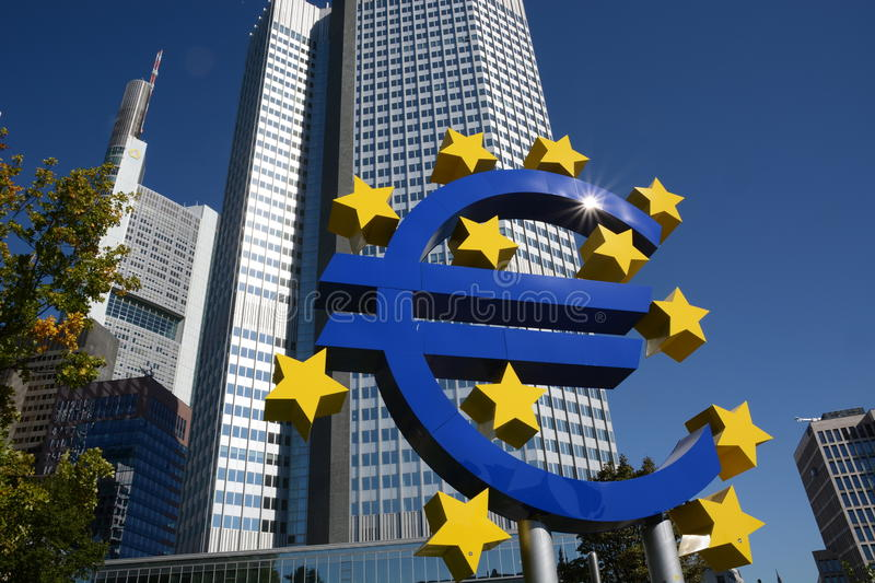 Euro crises. Frankfurt, Germany - October 1, 2015 - Tourist taking pictures in front of Euro Tower with euro sculpture during finance and refugee crises in royalty free stock photography