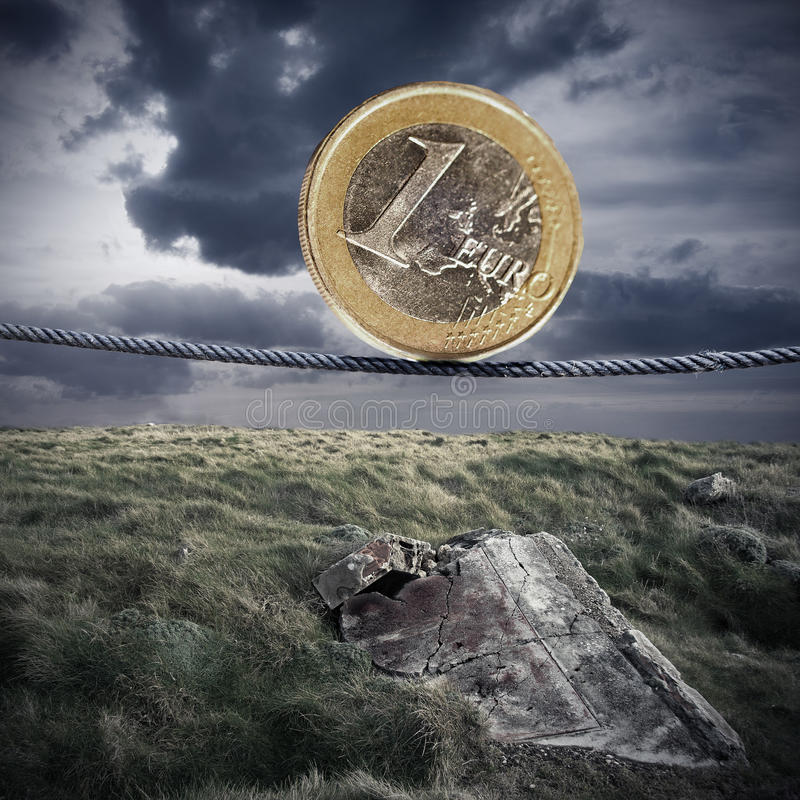 Euro crisis. Euro currency tightrope in the desolate landscape stock photo