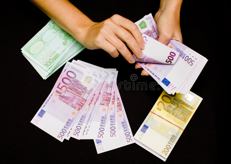 Euro currency in hands on black royalty free stock photos