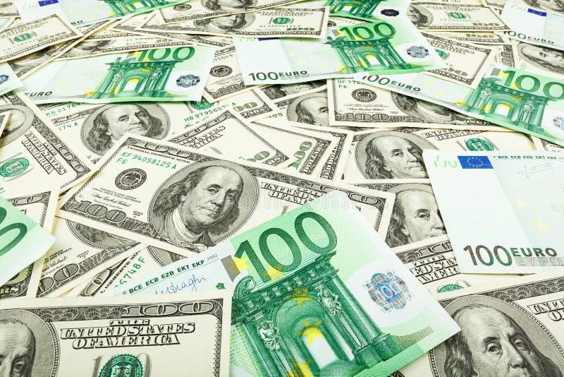 Euro de monnaie fiduciaire et dolar Fond des billets de banque photo libre de droits
