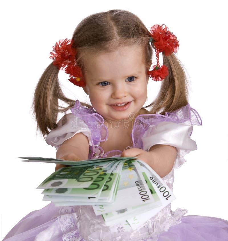Euro del dinero y muchacha del niño en alineada. imagenes de archivo