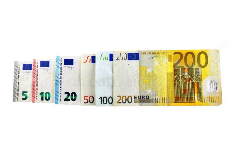 Euro die Geldbankbiljetten, op witte achtergrond worden geïsoleerd stock foto's