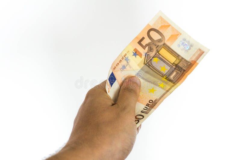 Euro do dinheiro 50 do whit da mão imagens de stock