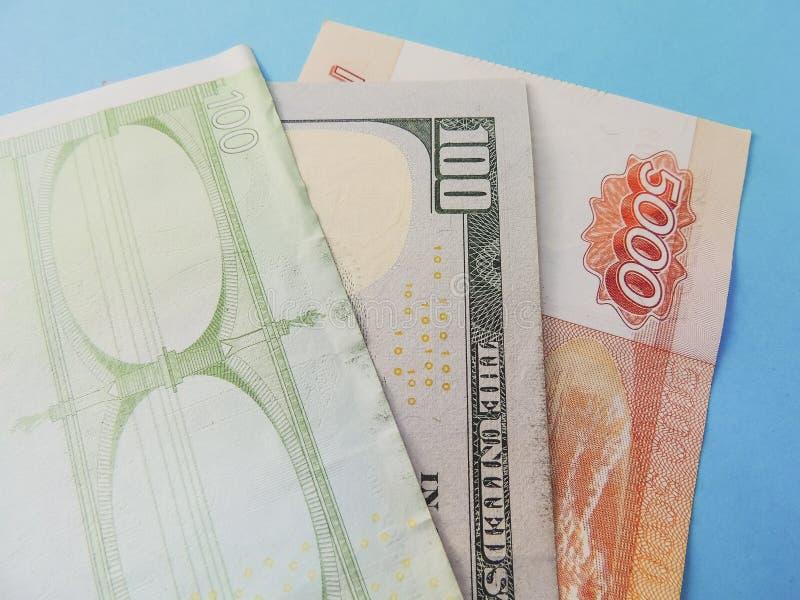Euro, dolar i Rosyjski rubel na błękitnym tle, zdjęcie stock