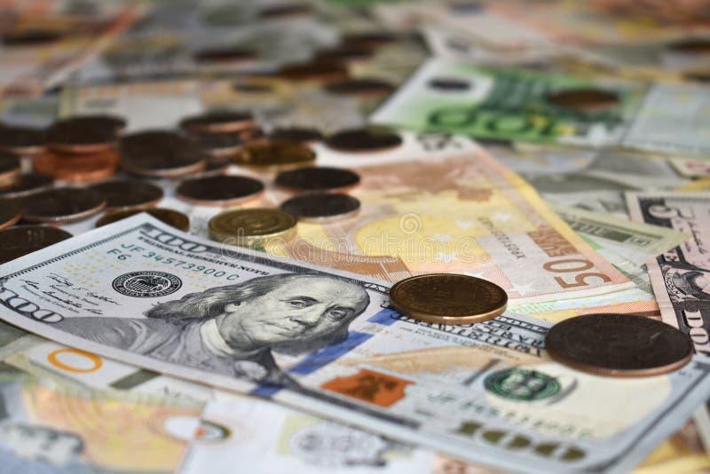 Euro e moedas dos dólares americanos fotografia de stock royalty free