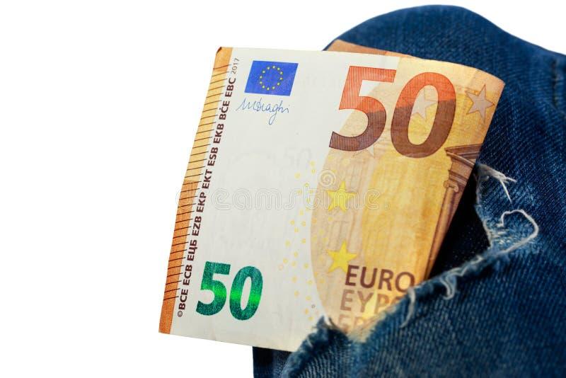 Euro em um furo da sarja de Nimes fotografia de stock