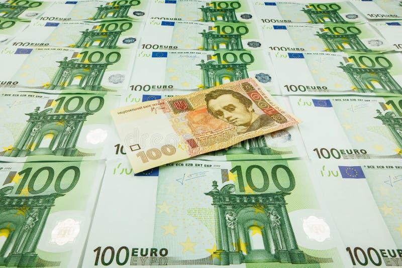 Euro et hryvnia de monnaie fiduciaire image libre de droits
