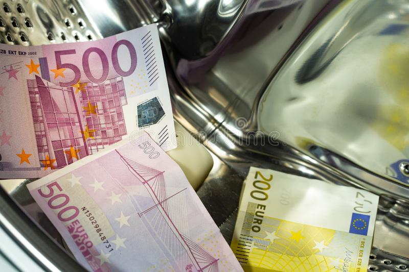 Euro / European currency, high denomination in the washing machine, money laundering concept. stock photos