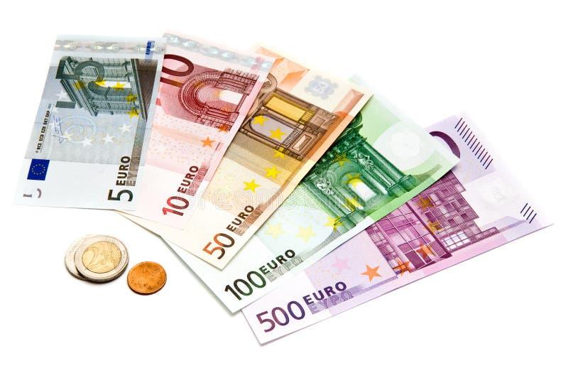 Euro fatture e monete fotografie stock