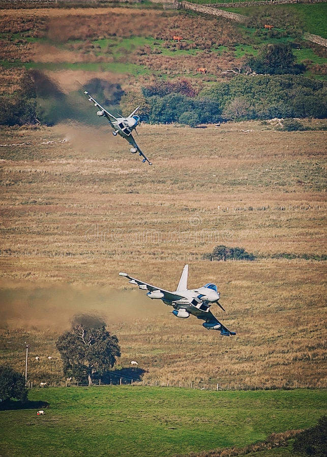 Euro fighter Typhoon jets. In a low level dogfight royalty free stock photos