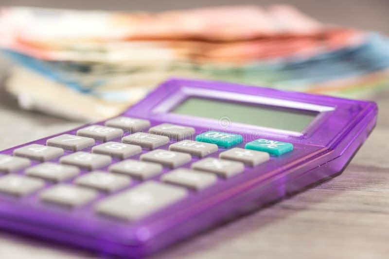 Euro geld en calculator royalty-vrije stock foto's